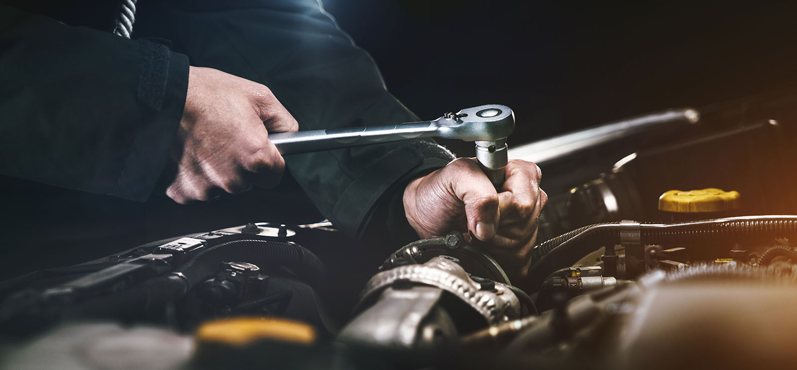 Auto technician working on engine